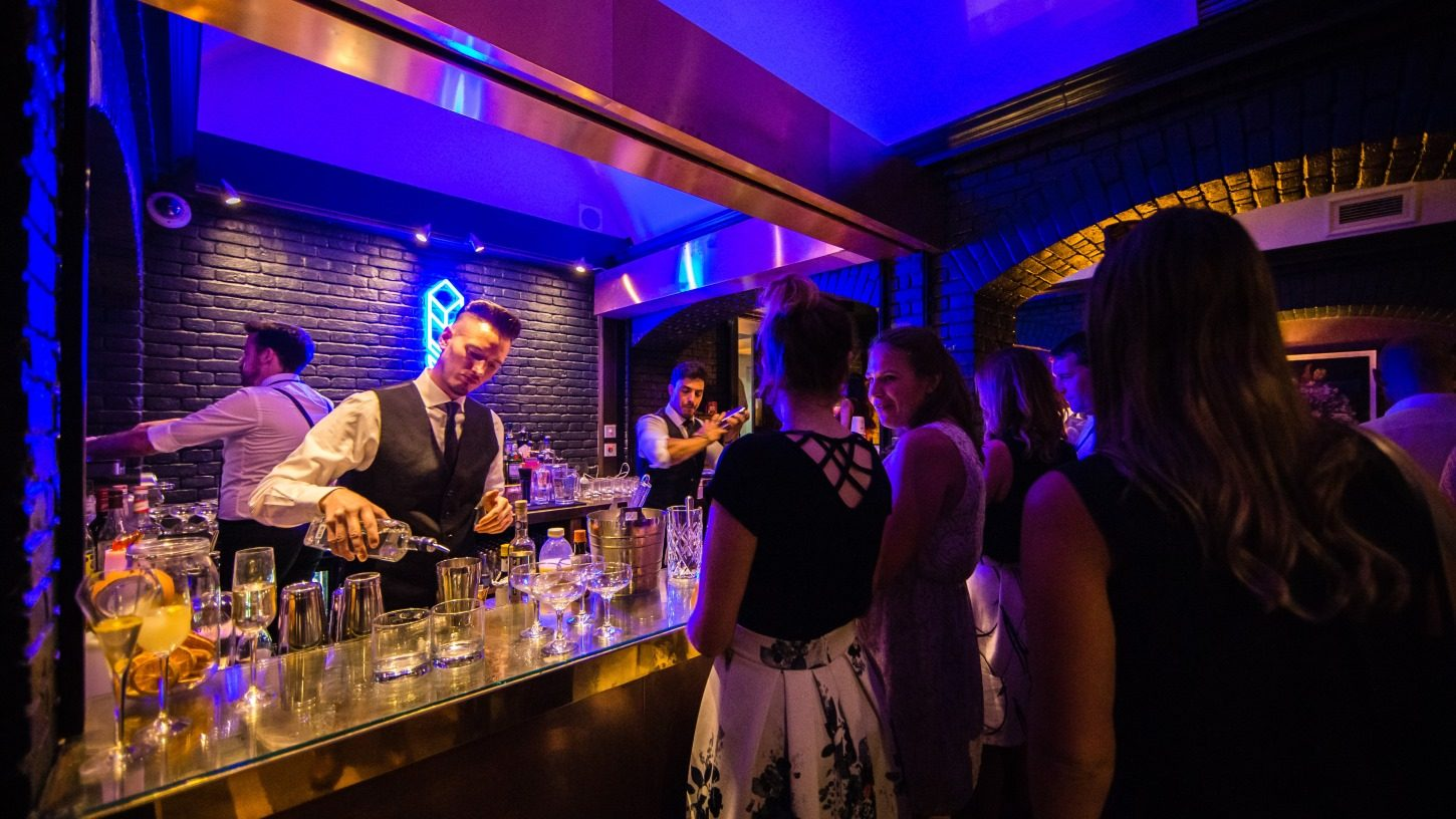 Drinks being served at the metallic bar